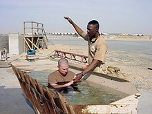 A baptism administered by a U.S. Navy chaplain in Iraq.