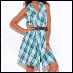 """Ruffled Plaid Shirtdress Ruffled Plaid Shirtdress- a cute breezy cotton teal plaid Shirtdress with cut out details in the back. The fabric is somewhat gauzy but not see-through. 100% cotton. Model is 5' 9"""", chest 32C, Waist 25"""", Hips 35"""" and is wearing a size Small. Boutique Dresses"""