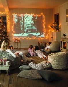 Create a cosy home cinema with an array of fleecy blankets, comfy throw cushions & beanbags.