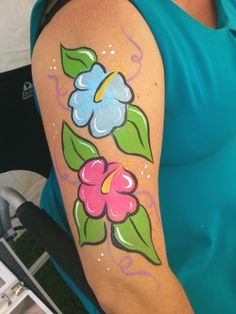 Cute easy cartoon style hibiscus flowers. Tropical hawaiian flowers. Face painting paint painter. Arm body art.