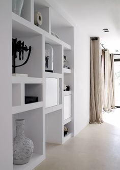 white shelving and fabulous curtains!