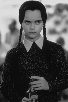 Christina Ricci as Wednesday in The Addams Family, & Addams Family Values