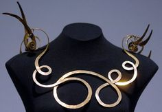 A brass wire necklace created in 1940 by Alexander Calder is called the Jealous Husband. ||  (Paul L. Newby, II | The Grand Rapids Press)