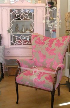 Pink vintage cabinet and pretty pink chair.