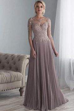 81f410bb33d5 Jacquelin Bridals Canada - 17860 - Mother of Bride - Full-length gown with  beaded lace on net bodice and sleeves accented by a drop waist.