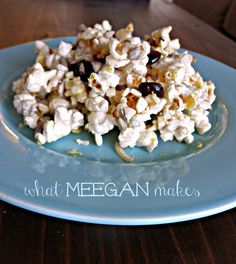 Healthy Popcorn Munch with honey, cinnamon, dried cranberries and sunflower seeds.  SO good!!  #whatmeeganmakes