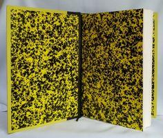 """Reliure """"L'aiguille Creuse"""" de Maurice Leblanc (Arsène Lupin). Papier Annonay jaune & noir pour les gardes"""