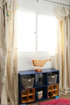 dropcloth turned over at top creates overhang Budget Makeover for a Boy's Bedroom with Curtain Tutorial