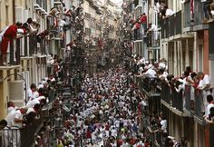 Pamplona, Spain  Crowds watch the fourth bull run of the week-long San Fermín festival. Two Spanish men were gored and another three were left with cuts and bruises after the bulls trampled and knocked over runners during this run Photograph: Jesus Diges/EP