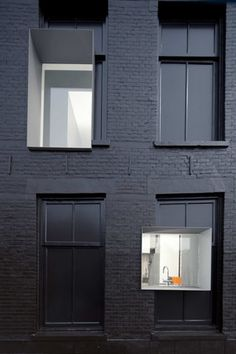 curious cut out window framing. love the matte black paint and the contrast of old & new design