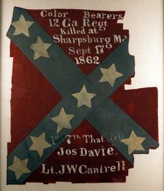 Flag of the 12th Georgia Infantry Regiment, 1861, Gift of the Muscogee County School District, 2005.22.1, This flag, carried at the Battle of Antietam, features names of color bearers killed in action. The regiment included several companies from the Columbus area.