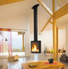 Suspended Focus Models Fireplace Design By Custom Fireplace Designs – 13 Custom Fireplace, Bedroom Fireplace, Wood Fireplace, Fireplace Design, Fireplace Ideas, Contemporary Wood Burning Stoves, Suspended Fireplace, Modern Tiny House, Interior Decorating