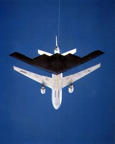 "B-2 ""SPIRIT"" Stealth Bomber aerial refueled from a KC-10."