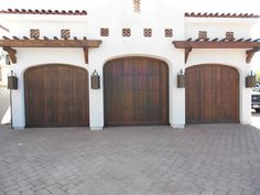 These garage doors in San Diego were designed to complement the Spanish Revival Architecture of a home in Olivenhain.  The garage doors are Clear Western Red Cedar that have been accented by decorative Clavos' and hinge straps. Medival?
