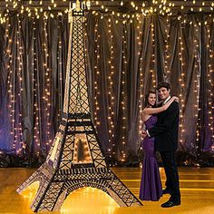 Our Tres Chic 3D Eiffel Tower Prop has the look of Paris' most recognizable monument, accented with the subtle glow of string lights.