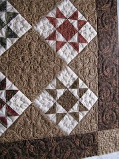 Ohio Star. Look at that quilting... it's beautiful.