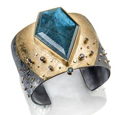 Sydney Lynch: Andromeda cuff; labradorite, black diamonds, blue tourmaline, 18k & 22k gold, oxidized silver. 1 3/4 inches wide.  $4840.