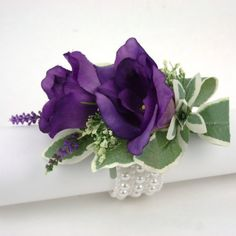 Purple Lisianthus Corsage seeded eucalyptus, limodium, bear grass, delphinium?