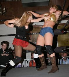 Amber O'Neil about to pound the abs of Lorelei Lee