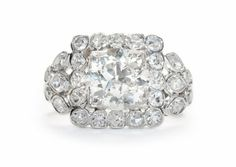 Parker is a stunning Art Deco vintage engagement ring featuring a 1.75ct Transitional cut diamond in a diamond studded geometric setting. Wowza! TrumpetandHorn.com | $14,500