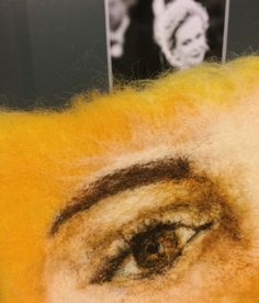 How to needle felt an watercolor like eye using grades of yellow.