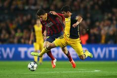 Diego Costa of Club Atletico de Madrid challenges Marc Bartra of Barcelona during the UEFA Champions League Quarter Final first leg match between FC Barcelona and Club Atletico de Madrid at Camp Nou on April 1, 2014 in Barcelona, Catalonia.