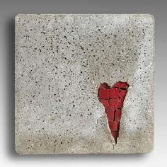 heart mosaic by Kim Wozniak -- love how it looks like the cement is closing over the top of the mosaic tiles