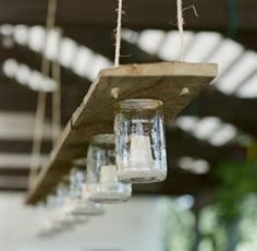 glass bottle and wood candle hanger