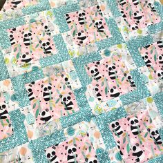 I love to give quilts for baby gifts!  Sometime there isn't enough time for an elaborate pattern.  This is my Go-To pattern for a baby quilt.  I put this Panda themed quilt top together in 1.…