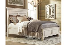 The very essence of cottage chic. Classic paneling and thick moulding give the Marsilona king panel bed a sculptural look. Textured distressing and a washed finish are vintage inspired and full of lasting appeal. Higher headboard sets the perfect stage for Euro pillows and other oversized pillows. Mattress and foundation/box spring sold separately.