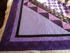 """When dealing with large open spaces I like to """"ghost"""" some element from the quilt. Quilting by Deborah Poole"""