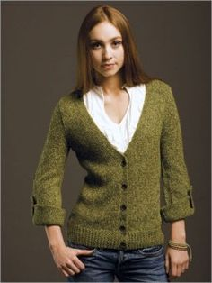 Emerald Isle Cardigan $ | InterweaveStore.com - knitted cardi with interesting fold-up cuff detail with a tab and two buttons for different sleeve length options.