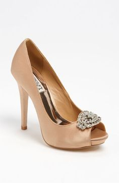 "Badgley Mischka 'Goodie' Pump  A bright satin pump is adorned with a sparkling crystal ornament just above the peep toe.  Approx. heel height: 4 1/4"" heel with 1/2"" platform.  Silk upper/leather lining and sole.  By Badgley Mischka; imported.  Salon Shoes.  item #514915  $245.00"