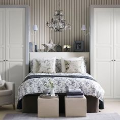 If your bedroom is all straight lines, cheat the look of alcoves by placing a wardrobe either side of your bed, then adding a shelf above the headboard. Use the open shelving to store bedtime reading and to display pictures and accessories.