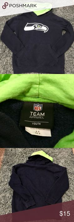 Seattle Seahawks Hoodie Sweatshirt Unisex Size youth 8 or small Seattle Seahawks pullover hoodie sweatshirt Bright green inside the hood Like new. I think it's only been worn once NFL Team Apparel Shirts & Tops Sweatshirts & Hoodies
