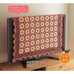 Love the idea of covering the TV with a beautiful blanket. So much prettier when you have company over!