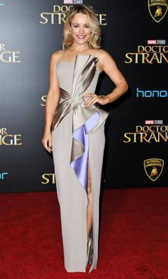 RACHEL MCADAMS   in a silver Atelier Versace gown featuring a thigh-high slit and ruffle revealing its lilac lining, plus H. Stern jewelry, at the premiere for her movie Doctor Strange in L.A