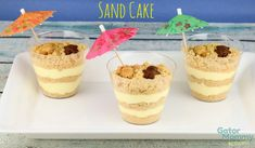 Sand Cake is a twist on the classic dirt cake recipe (golden Oreos). It also makes a great dessert for a beach themed party. Great Desserts, Köstliche Desserts, Delicious Desserts, Dessert Recipes, Beach Themed Desserts, Beach Theme Food, Yummy Recipes, Cupcakes, Cupcake Cakes