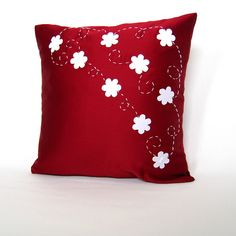 Update your home decor with this luxurious pillow cover. This deep red pillow cover is made with heavy satin and hand-cut white little flowers (appliqués). The appliqués were fused on to minimize fraying and then hand embroiled for an exclusive look. Продажа недвижимости в Аликанте ! лучшее вложение денег ! #Испания #Аликанте http://novostroica.com/