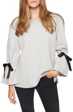 Free shipping and returns on Sanctuary Tierney Tie Sleeve Sweatshirt at Nordstrom.com. Cozy and frilly come together beautifully in this soft cotton sweatshirt with sweet satin bows cinching the bell sleeves.