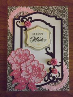 Anna Griffin new Fretwork die in the corners.  Flowers are from AG's Elegant Embellishments cartridge and the frame is Cricut Lacy Labels.