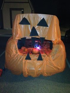My very own Pumpkin trunk or treat!! Super easy with orange table cloths and cardboard I painted black. Did a ring toss with glow necklaces and the pumpkins inside. Candy prizes of course! Kids loved it!! October 28, 2012 @ Black Mountain Baptist Church -Kali Ezell
