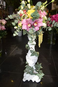 Table centerpiece made on ceramic candleholder,with purple cimbidium orchid flowers,cinerea eucalyptus,eryngium questar,white wax flower,white lisianthus,amaranthus and mixed roses,designed by Adrian Ionita