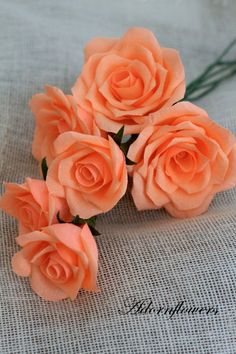 Six realistic looking paper roses by adornflowers on Etsy, $42.00