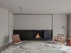 Project DD is a minimalist residence designed by Belgium-based architect Pieter Vanrenterghem Custom Fireplace, Wood Fireplace, Fireplaces, Foyers, Organiser Son Dressing, Walnut Timber, Timber Beams, Hall Design, Open Plan Living