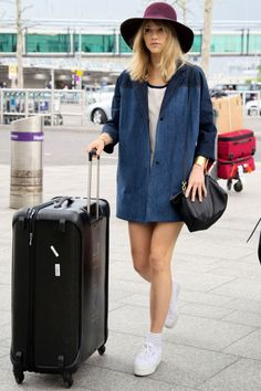 Suki Waterhouse Does Airport Style To Perfection At Heathrow Airport, 2014