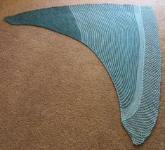 """My first mult-colored shawl! Meteor Shower is the third shawl in my """"Astronomy"""" shawl collection. This is a highly adjustable pattern that comes with instructions for a two-skein symmetrical triangular shawl, a two-skein asymmetrical shawl, and a one-skein asymmetrical shawl. The way the pattern is written, it can easily be up- or down-sized to your liking. The pattern is worked sideways and features a knitted on i-cord that creates a nice, curved neckline on one side with a blackbe..."""