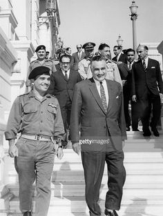 King Hussein of Jordan (1935 - 1999) (l) and Egyptian President Gamal Abdul Nasser (1918 - 1970) smile after signing a Jordan-Egyptian defense agreement June 1967 in Cairo.
