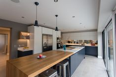 Planet Furniture create bespoke handcrafted kitchens and Furniture. Come visit our showrooms in Hitchin, Hertfordshire. Kitchen Furniture, Sliding Doors, Bespoke, Planets, Interior Design, Table, House, Cabinets, Contrast