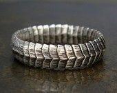 Marcus Berkner Jewelry.  Love his stuff!